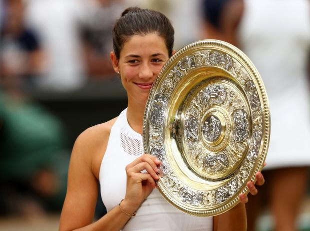 Muguruza tears Venus to win Wimbledon crown