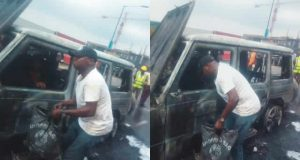 Fayose's burnt G-Wagon with the driver evacuating cash