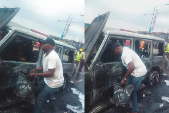 Fayose's G-Wagon razed in Lagos, driver seen evacuating burnt cash (Pictures)