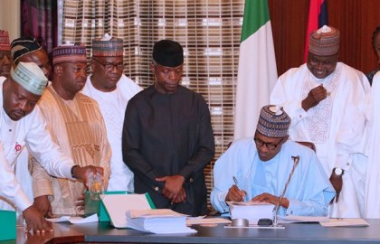 Buhari signs 2018 budget, laments slashing of projects and introduction of others