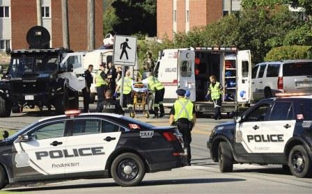 Two police officers, others killed in Canada shooting