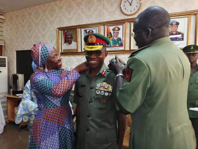 R- Chief of Army Staff, Lt.-Gen. Tukur Buratai and the Peanent Secretary, Ministry of Defence, Mrs Nuratu Batagarawa decorating the newly promoted Lt.-Gen. Lamidi Adeosun (Middle) in Jaji, Kaduna State on 12/7/2019